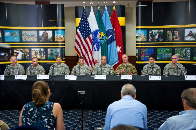 1st Lt. Shaye L. Haver (fourth from left) answers a reporter's question about her 62-day journey through Ranger school at a press panel at Fort Benning, Ga., Aug. 20, 2015. From left to right are class graduates: 2nd Lt. Erickson Krogh, 2nd Lt. Anthony Rombold, 2nd Lt. Michael Janowski, Haver, Staff Sgt. Michael Calderon, Spc. Christopher Carvalho, Capt. Kristen M. Griest and 2nd Lt. Zachary Hagner.