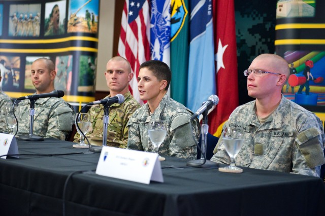 Capt. Kristen M. Griest, center, answers a reporter's question about her 62-day journey through Ranger School at a press panel at Fort Benning, Ga., Aug. 20, 2015.