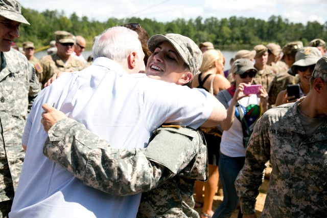 A Family member hugs Capt. Kristen M. Griest, after pinning the Ranger Tab on her sleeve. Griest is one of two women to ever graduate Ranger School.  She was among 96 Soldiers who graduated Ranger School at Fort Benning, Ga., Aug. 21, 2015.