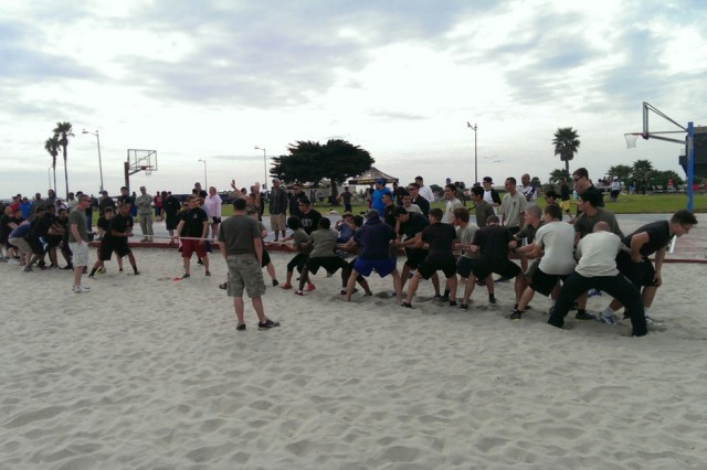 Future Soldiers in the Delayed Entry Program get some exercise at Mission Beach in San Diego, in February 2015.