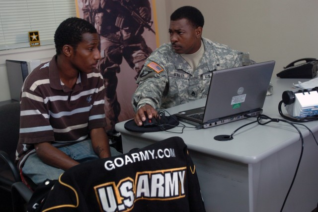 Staff Sgt. Roger L. Whaley speaks with Phillip McDonald about the possibility of becoming a journalist or X-ray technician for the Army at the U.S. Army Recruiting Station in Radcliff, Ky.