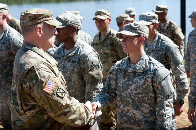Maj. Gen. Scott Miller, commander, Maneuver Center of Excellence, shakes hands with Capt. Kristen M. Griest, one of the latest Soldiers to earn the Ranger tab, Aug. 21, 2015, at Fort Benning, Ga.
