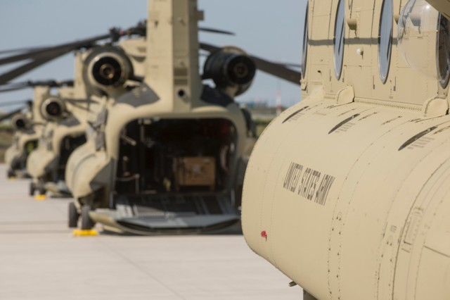 CH-47 Chinook helicopters from Hotel Company 1-214th Aviation Regiment, 12th Combat Aviation Brigade, park at a local German airport for refueling in the new MYII models Aug. 21, 2015. The new helicopters will provide 12th CAB with the latest and most cutting-edge CH-47F platform to-date that will ensure combat readiness, which incorporates reliability, maintainability improvement modifications and current modernization programs.