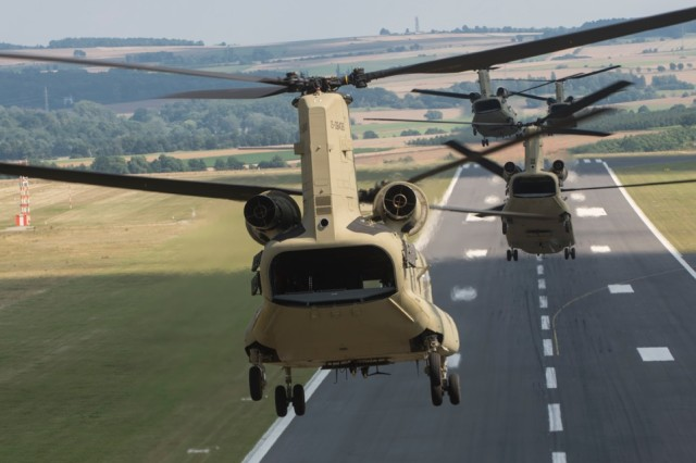 CH-47 Chinook helicopters from Hotel Company 1-214th Aviation Regiment, 12th Combat Aviation Brigade, take off after refueling at a local German airport in the new MYII models Aug. 21, 2015.  The new helicopters will provide 12th CAB with the latest and most cutting-edge CH-47F platform to-date that will ensure combat readiness, which incorporates reliability, maintainability improvement modifications and current modernization programs.