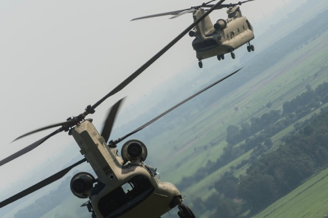 CH-47 Chinook helicopters from Hotel Company 1-214th Aviation Regiment, 12th Combat Aviation Brigade, fly in a convoy formation in the new MYII models Aug. 21, 2015.  The new helicopters will provide 12th CAB with the latest and most cutting-edge CH-47F platform to-date that will ensure combat readiness, which incorporates reliability, maintainability improvement modifications and current modernization programs.