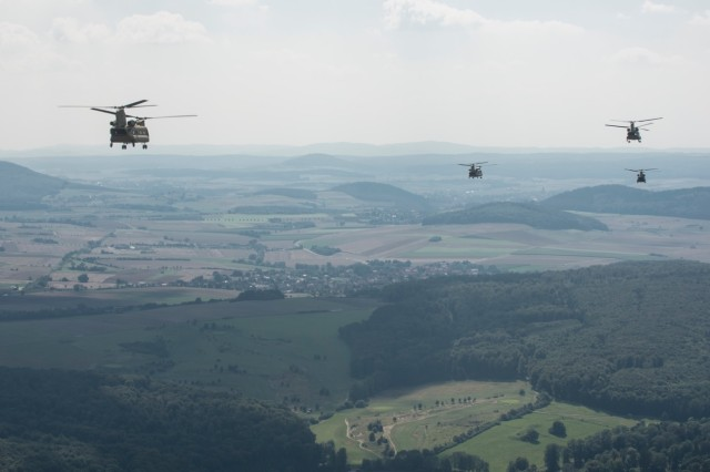 CH-47 Chinook helicopters from Hotel Company 1-214th Aviation Regiment, 12th Combat Aviation Brigade, fly over Germany in the new MYII models Aug. 21, 2015.  The new helicopters will provide 12th CAB with the latest and most cutting-edge CH-47F platform to-date that will ensure combat readiness, which incorporates reliability, maintainability improvement modifications and current modernization programs.