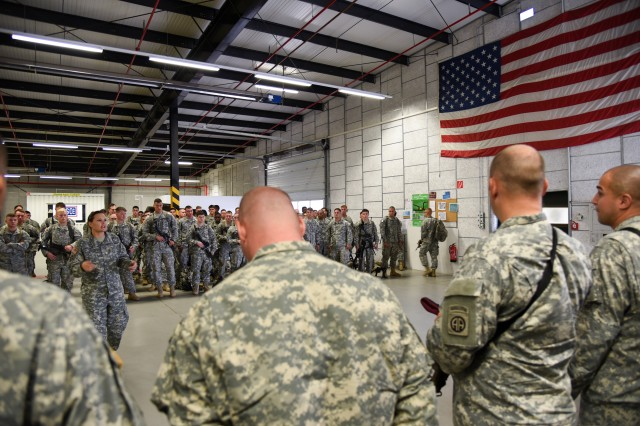 Paratroopers, with 1st Brigade Combat Team, 82nd Airborne Division, receive a welcome briefing at the deployment processing center on Rhine Ordnance Barracks in Kaiserslautern, Germany, Aug. 17, 2015.