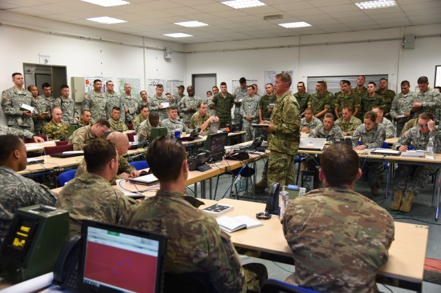 Col. Colin P. Tuley, commander, 1st Brigade Combat Team, 82nd Airborne Division, provides command guidance to leaders of Task Force Devil, a multinational force, executing a combined training exercise at Smith Barracks in Baumholder, Germany, Aug. 20, 2015.