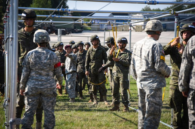 Jumpmasters, with 1st Brigade Combat Team, 82nd Airborne Division, conduct airborne sustainment training with paratroopers from Task Force Devil, a multinational force, at Smith Barracks in Baumholder, Germany, Aug. 23, 2015.