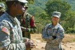 U.S. Army Sgt. Cristina Viveros, a military policeman with the 93rd Military Police Battalion, goes over a tactical movement brief with the Zambian Defense Force military police during Southern Accord 2015 in Lusaka, Zambia on Aug. 10. The annual exercise provides U.S. military, United Nations allies and the Zambian Defense Force an opportunity to work and train together as a joint, combined peacekeeping allied force.
