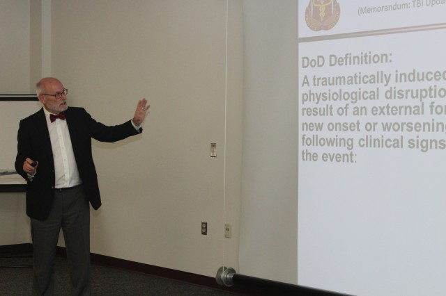 Dr. Donald Marion, senior clinical consultant with the Defense and Veterans Brain Injury Center, spoke during a seminar designed to share updated information on the management and treatment of traumatic brain injury with staff from the U.S. Army Medical Research and Materiel Command's Combat Casualty Care Research Program, Aug. 7, 2015.