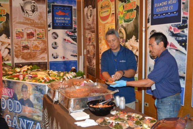 Vendors at Diamond Head Seafood display their wares and cook up some delicacies for passersby at Tuesday's (Aug. 18) 2015 ALA Hawaii Show.