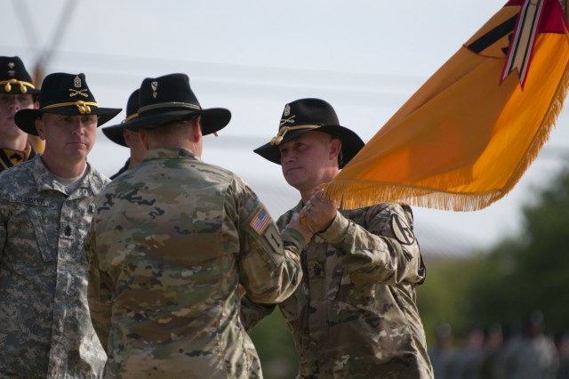 Command Sgt. Maj. Scott Peare (left), former command sergeant major of the 3rd Armored Brigade Combat Team, 1st Cavalry Division, passes the brigade colors to Col. Matthew Van Wagenen, commander of the 3rd ABCT, relinquishing his responsibilities during a change of responsibility ceremony Aug. 14 at Fort Hood, Texas.