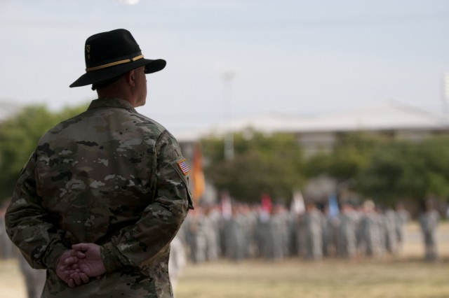 Command Sgt. Maj. Scott Peare, former command sergeant major of the 3rd Armored Brigade Combat Team, 1st Cavalry Division looks out at the brigade formation before relinquishing his position as the senior enlisted advisor during a change-of-responsibility ceremony Aug. 14 at Fort Hood, Texas. Peare noted in his speech that this is most likely his last assignment that would allow him to develop Soldiers directly.