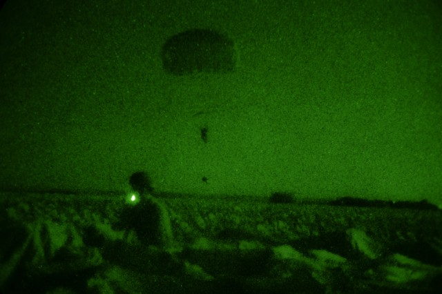 A U.S. Army paratrooper assigned to the 173rd Airborne Brigade lands on a drop zone while conducting airborne operations during exercise Swift Response 15 near the Novo Selo Training Area in Tenevo, Bulgaria, Aug. 24, 2015. Swift Response is a large-scale multinational airborne exercise involving 4,500 troops from 11 NATO nations and takes place across Bulgaria, Germany, Italy and Romania. (Photo by U.S. Army Spc. Brian Chaney, Viper Combat Camera Team)