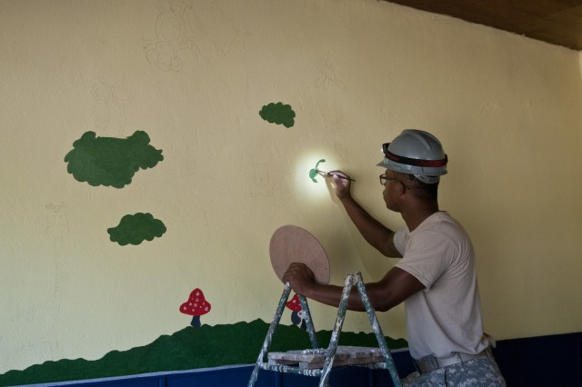 U.S. Army Reserve Sgt. Cody Lightfoot, construction engineer, 390th Engineer Company, paints a mural for the children of the school. The 390th Engineer Company out of Chattanooga, Tenn., partnered with the Bulgarian Army to renovate two classrooms and a bathroom for the Tsersova Koria, Bulgaria, kindergarten Aug. 3 to 19 for a Humanitarian Civil Assistance project funded by U.S. European Command through the U.S. Office of Defense Cooperation Bulgaria. (U.S. Army photo by Staff Sgt. Debralee Best)