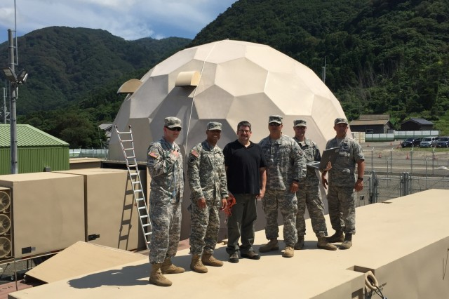 Signal Soldiers from the 94th Army Air and Missile Defense Command, 78th Network Enterprise Center, and the 307th Expeditionary Signal Battalion pose for a photo after integrating signal equipment for the 14th Missile Defense Battery, 94th AAMDC.