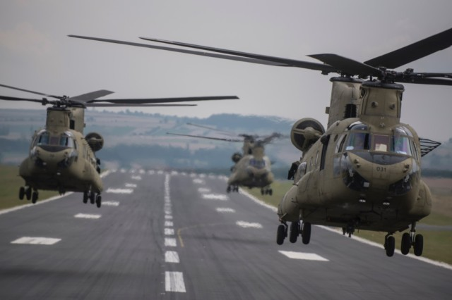 CH-47 Chinook helicopters from Hotel Company 1-214th Aviation Regiment, 12th Combat Aviation Brigade, take off enroute to Bremerhaven port, Aug. 21, 2015.  The new MYII helicopters will provide 12th CAB with the latest and most cutting-edge CH-47F platform to-date that will ensure combat readiness, which incorporates reliability, maintainability improvement modifications and current modernization programs.