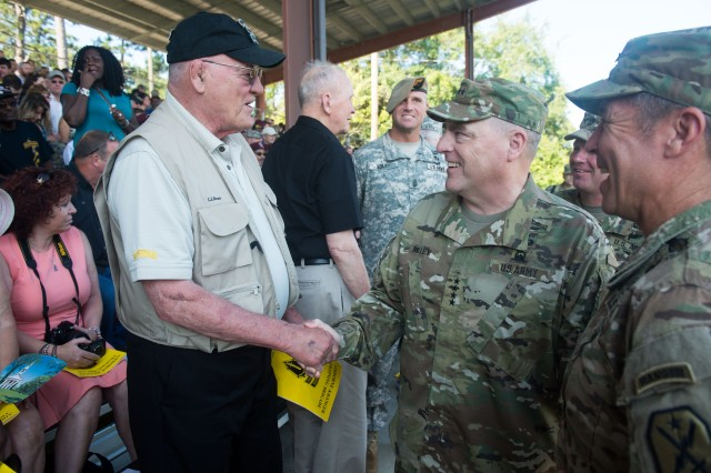 U.S. Army Chief of Staff Gen. Mark A. Milley interacts with U.S. Army Ranger Veterans before the Airborne and Ranger Training Brigade graduated U.S. Army Ranger School Class 08-15 at Fort Benning, GA, Aug. 21, 2015.  Class members Cpt. Kristen Griest and 1st Lt. Shaye Haver became the first female graduates of the school.  (U.S. Army photo by Staff Sgt. Steve Cortez/ Released)