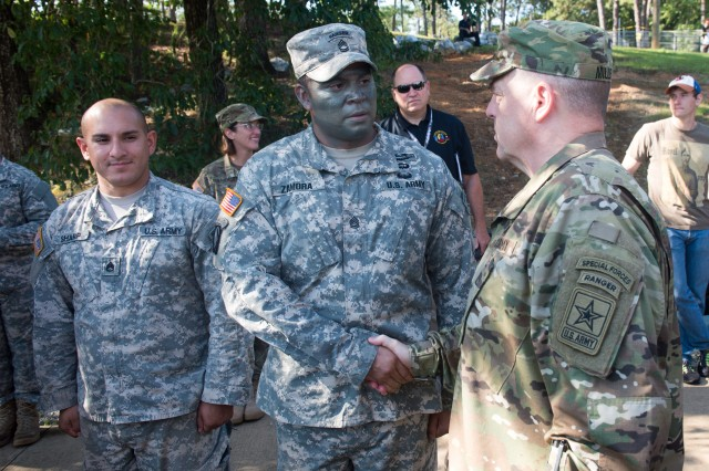 U.S. Army Chief of Staff Gen. Mark A. Milley interacts with U.S. Army Ranger instructors before the Airborne and Ranger Training Brigade graduated U.S. Army Ranger School Class 08-15 at Fort Benning, GA, Aug. 21, 2015.  Class members Cpt. Kristen Griest and 1st Lt. Shaye Haver became the first female graduates of the school.  (U.S. Army photo by Staff Sgt. Steve Cortez/ Released)