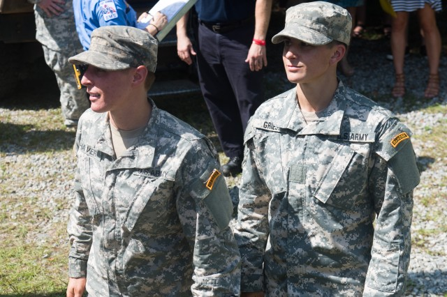 Cpt. Kristen Griest (right) and 1st Lt. Shaye Haver (left) receive their Ranger tab during their graduation From the U.S. Army Ranger School at Fort Benning, GA, Aug. 21, 2015.  Griest and Haver became the first female graduates of the school.  (U.S. Army photo by Staff Sgt. Steve Cortez/ Released)