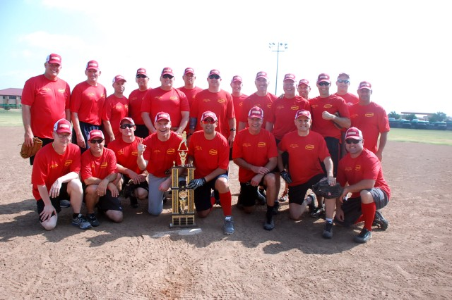 Commanders' teammates pose for a photo with their trophy after winning the Commanders vs. Sergeants Major softball game, 21-15, on Aug. 22, 2015, at Fort Sill's Cannoneer Complex. The win kept the Brass Dynasty in place as the commanders now have five consecutive victories in the annual game.