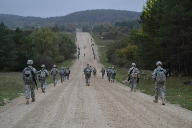 Soldiers  from the 428th & 309th Engineer Companies (Mobility Augmentation), stationed in Wausau, Wis., and Brainerd, Minn., conduct a road march during a training exercise in Hohenfels, Germany, Oct. 26, 2014. (U.S. Army photo by Spc. Santiago Alameda/Released)