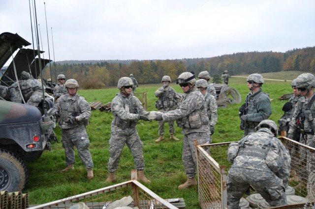 Soldiers  from the 428th & 309th Engineer Companies (Mobility Augmentation), stationed in Wausau, Wis., and Brainerd, Minn., load up training mines for an operational forces training exercise in Hohenfels, Germany, Oct. 30, 2014. (U.S. Army photo by Spc. Santiago Alameda/Released)