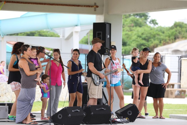 Families dance with the band during the 1st Battalion, 1st Special Forces Group's annual Welcomefest, which featured a variety of activities for Soldiers and their Families.