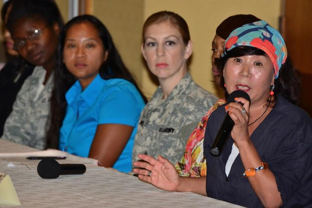 Myeong Sook Suh, President of the Jeju Olle and one of seven panel members that took part in the Eighth Army Women's Equality Day Educational Panel answers a question asked by one of the audience members on gender equality Aug. 26, 2015 at U.S. Army Garrison Yongsan in Seoul, South Korea. The educational panel brought experts and community members together to discuss current social issues that continue to serve as barriers to gender equality in the military and the civilian sector.