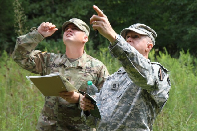 Students of the Horizontal Construction Engineers Senior Leader Course work together to calculate the rapid classification of a fixed bridge at the Fort Leonard Wood, Mo., multi-purpose bridge site during a field exercise.