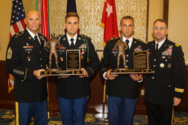 The two winners of the 2015 U.S. Army Forces Command Non-Commissioned Officer and Soldier of the Year Competition, are awarded engraved plaques for their victory, Fort Bragg, N.C. 27 Aug. 2015.  Sgt. Justin M. McLendon, centered left, Infantryman, A Co, 2nd Battalion, 4th Infantry Regiment, 4th Brigade Combat Team, 10th Mountain Division, receives his plaque from Command Sgt. Maj. Scott C. Schroeder, left, Command Sergeant Major of U.S. Army Forces Command. Sgt. James Gawlowski, centered right, squad leader, D Co, 3rd Battalion, 4th Air Defense Artillery Regiment, 108th ADA Brigade, receives his plaque from Gen. Robert B. Abrams, Commanding General of U.S. Army Forces Command.