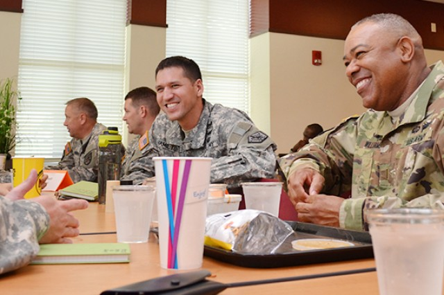 Chief Warrant Officers 4 Bill Kearns (from left) and Thomas Hamilton share a light moment with Army Staff Senior Warrant Officer, Chief Warrant Officer 5 David Williams, and other HRC warrant officer career managers at the HRC Café Aug. 26.