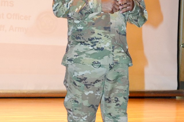 Army Staff Senior Warrant Officer, Chief Warrant Officer 5 David Williams, addresses warrants from a range of units across Fort Knox during a professional development session at the Waybur Theater Aug. 27.