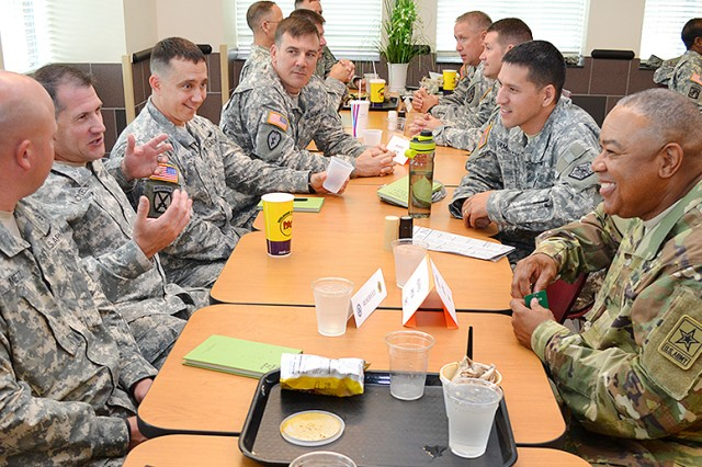 Army Staff Senior Warrant Officer, Chief Warrant Officer 5 David Williams (right), mixes shop talk and humor while having lunch with HRC warrant officer career managers at the HRC Café Aug. 26.