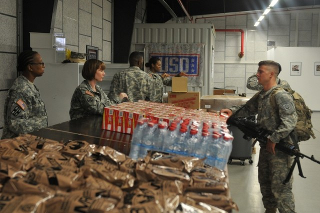 Soldiers with the 3rd Expeditionary Sustainment Command provide water and rations to Soldiers at the theater gateway at Rhine Ordnance Barracks in Kaiserslautern, Germany. The 3rd ESC was deployed to support XVIII Airborne Corps during Operation Swift Response. (U.S. Army photo by Staff Sgt. Justin Silvers)