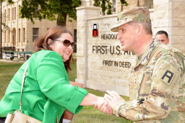 Maj. Gen. Paul Benenati, First Army deputy commanding general for support, welcomes Kate Jennings to First Army headquarters on Rock Island Arsenal, Rock Island Arsenal, August 27. Jennings serves as a staff assistant in Sen. Dick Durbin's office.