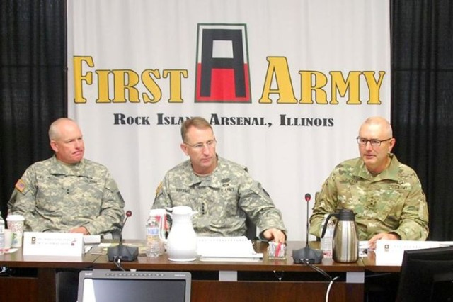 Gen. Robert B. Abrams, U.S. Forces Command Commanding General (center), receives a briefing on First Army's mission from Lt. Gen. Michael S. Tucker (right), First Army commanding general. Tucker was joined by his staff for the briefing including, Maj. Gen. Charles W. Whittington, First Army deputy commanding general for operations, (left). The briefing was held in First Army Headquarters' Pershing Conference Room at Rock Island Arsenal, Ill., September 2.