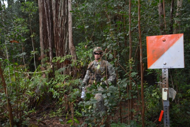 SCHOFIELD BARRACKS, Hawaii -- Expert Infantry Badge candidate assigned to 25th Infantry Division finds a point during the land navigation portion of the 25th ID EIB Testing Aug. 25 on Schofield Barracks. The EIB training was conducted under realistic conditions designed to recognize outstanding infantryman and Soldiers who attain a high degree of professional skill, expertise and excellence in a broad spectrum of critical tasks. (U.S. Army photo by Staff Sgt. Carlos Davis, 2nd Stryker Brigade Combat Team Public Affairs/Released).