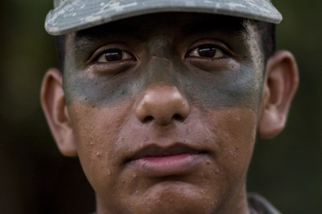 A U.S. Army Reserve combat engineer from the 374th Engineer Company (Sapper), out of Concord, Calif., poses for a photo wearing face paint before heading off into the X-Mile event, a final race stretching approximately five miles with various challenges along the way to determine the winning team of Sapper Stakes 2015 at Fort Chaffee, Ark., Sept. 1. The competition is designed to build teamwork, enhance combat engineering skills and promote leadership among the units. (U.S. Army photo by Master Sgt. Michel Sauret)