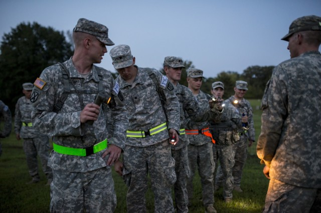 U.S. Army Reserve combat engineers from 402nd Engineer Company (Sapper), from Des Moines, Iowa, test their flash lights before going into the X-Mile event, a final race stretching approximately five miles with various challenges along the way to determine the winners of Sapper Stakes 2015 at Fort Chaffee, Ark., Sept. 1. The competition is designed to build teamwork, enhance combat engineering skills and promote leadership among the units. (U.S. Army photo by Master Sgt. Michel Sauret)