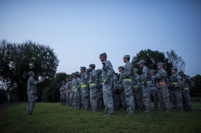 The top eight U.S. Army Reserve and National Guard combat engineer teams receive their briefing on the X-Mile event, a final race stretching approximately five miles with various challenges along the way to determine the winners of Sapper Stakes 2015 at Fort Chaffee, Ark., Sept. 1. The competition is designed to build teamwork, enhance combat engineering skills and promote leadership among the units. (U.S. Army photo by Master Sgt. Michel Sauret)