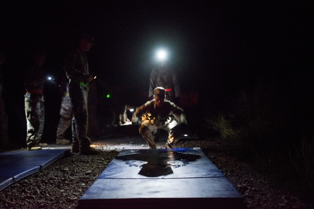 A U.S. Army Reserve combat engineer with the 402nd Engineer Company (Sapper), from Des Moines, Iowa, has to perform burpees as a penalty for failing an event during the X-Mile march, a final race stretching approximately five miles with various challenges along the way to determine the winners of Sapper Stakes 2015 at Fort Chaffee, Ark., Sept. 1. The competition is designed to build teamwork, enhance combat engineering skills and promote leadership among the units. (U.S. Army photo by Master Sgt. Michel Sauret)