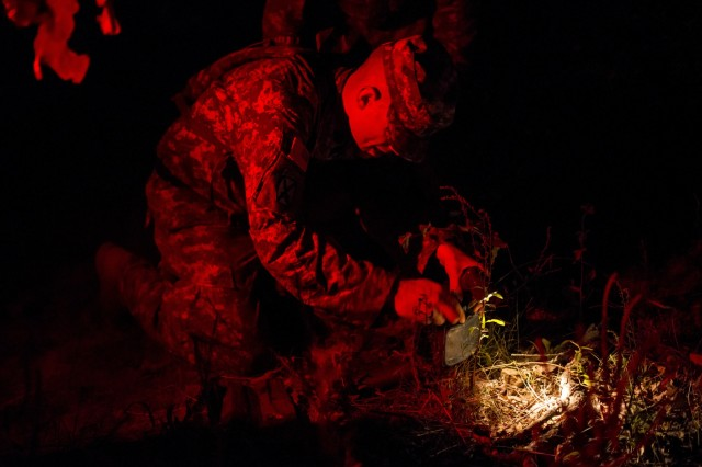 A U.S. Army Reserve combat engineer with the 402nd Engineer Company (Sapper), from Des Moines, Iowa, sets up an M18 claymore mine during a mystery event on the X-Mile march, a final race stretching approximately five miles with various challenges along the way to determine the winners of Sapper Stakes 2015 at Fort Chaffee, Ark., Sept. 1. The competition is designed to build teamwork, enhance combat engineering skills and promote leadership among the units. (U.S. Army photo by Master Sgt. Michel Sauret)