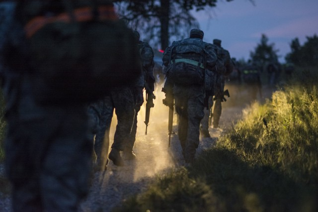 U.S. Army Reserve and National Guard combat engineer teams conduct a 12-mile ruck march through the dusty hills and roads of Fort Chaffee, Ark., during Sapper Stakes 2015, Aug. 31. The road march was graded as a team event, and it was said by several competitors that it was the hardest and most physically challenging event from the entire competition. In all, the combat engineers marched more than 40 miles by foot throughout Sapper Stakes. The competition is designed to build teamwork, enhance combat engineering skills and promote leadership among the units. (U.S. Army photo by Master Sgt. Michel Sauret)