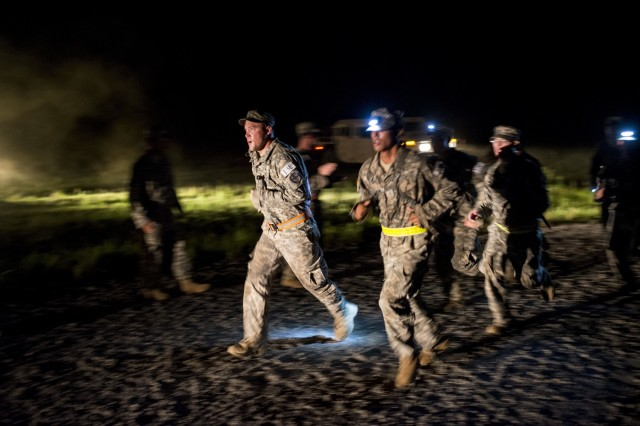 U.S. Army Reserve combat engineers from the 391st Engineer Company, of Boise, Idaho, run toward the finish line of the X-Mile event, a final race stretching approximately five miles with various challenges along the way to determine the winners of Sapper Stakes 2015 at Fort Chaffee, Ark., Sept. 1. The competition is designed to build teamwork, enhance combat engineering skills and promote leadership among the units. (U.S. Army photo by Master Sgt. Michel Sauret)
