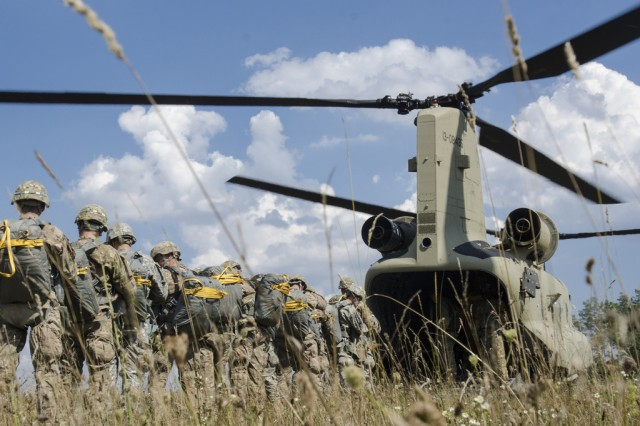 Paratroopers from 173rd Airborne Brigade load into a CH-47F MYII Chinook Helicopter for their training jump. 12th Combat Aviation Brigade sent two of the new Chinook Helicopters to support 280 Soldiers of 1st Squadron, 91st Cavalry Regiment, 173rd Airborne Brigade, for airborne training at the Grafenwoehr Training Area - Bunker DZ, in Germany, Aug. 31, 2015.