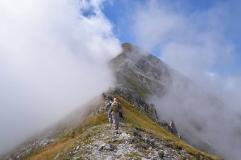 U.S. Army Soldiers hike to the peak of Mount Ljubo