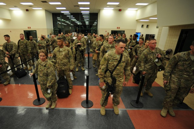 III Corps Soldiers wait for their final manifest check-in at Robert Gray Army Airfield at Fort Hood, Texas, Aug. 29, to board a flight and deploy in support of Operation Inherent Resolve. (U.S. Army photo by Nick Conner, Fort Hood Public Affairs)