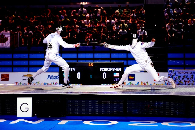 Spc. Nathan Schrimsher of the U.S. Army World Class Athlete Program defeats Emmanual Zapata of Argentina in a fencing bonus round bout en route to earning a berth in the 2016 Olympic Games with a third-place finish in men's Modern Pentathlon at the 2015 Pan American Games in Toronto on July 19. U.S. Army photo by Tim Hipps, IMCOM Public Affairs